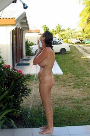 Jaw-dropping ladies washing in outdoor shower, wet sweeties